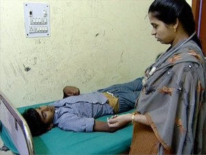 Sick boy is tended by a female doctor.