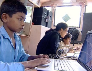 Young boy works on his computer.