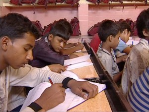 Boys in class learn to be journalists